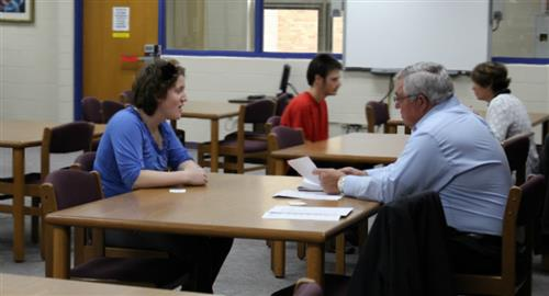 students participating in mock interviews
